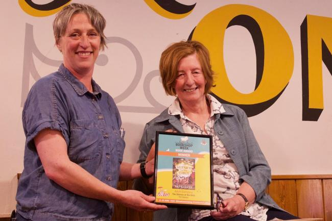 Forum Books owner Helen Stanton presents author Pat Barker with the Book of the Year Award.                                       Photo: IAN WYLIE