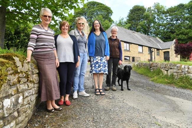 Humshaugh Village Hall committee members Diana Linnett, Sue Birleson, Jill Bauld and Suzanne Newell are pictured with resident Liz Campbell and Teal the dog. 			    Photo: HX251918