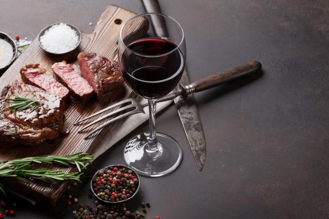 A Generic Photo of barbecued steak with seasoning and glass of red wine. See PA Feature DRINK BBQ Red. Picture credit should read: PA Photo/iStock. WARNING: This picture must only be used to accompany PA Feature DRINK BBQ Red...