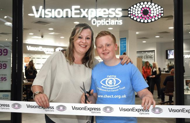 James Marshall with his mum, Julie Weatherly, at the new Vision Express Metrocentre store.  														      Photo: IAN McCLELLAND
