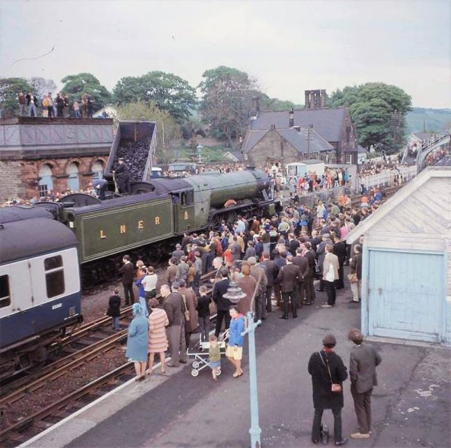 Crowds of people turned out in Haltwhistle on June 11, 1969, to see the Flying Scotsman taking on a fresh tender full of coal, supplied by Wardles. 						                  Photo: IVOR BURROW