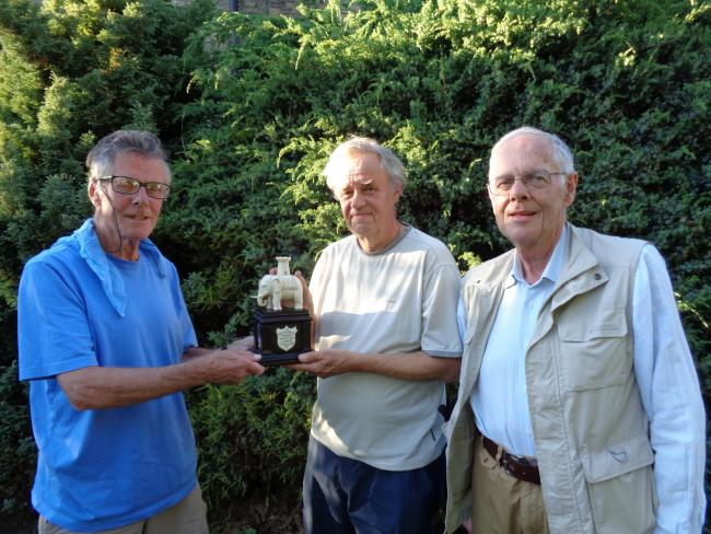 Steve Larkin (left) presents the trophy to David Wrigley, with Bruce Reed.