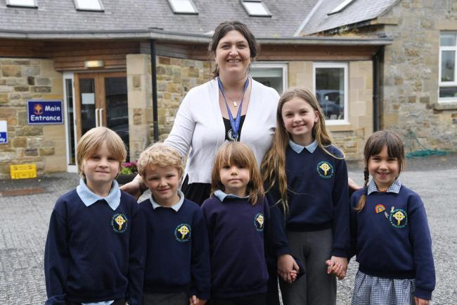 Whitfield Primary School pupils Monty May, Fergie Hoskyns-Abrahall, Zach May, Ella May, Gwen Clay-Wallers with headteacher Katherine Ayre celebrate their recent good SIAMS report.      Photo: HX281946