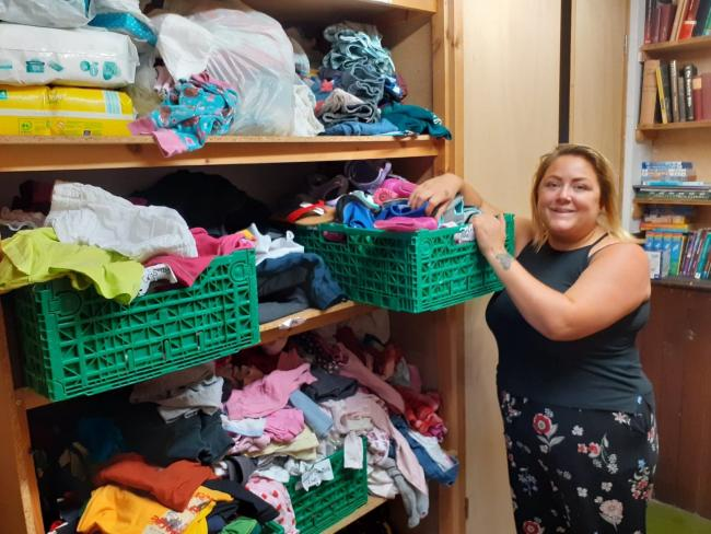 Hexham Children and Baby Bank founder Rosie Gilchrist sorts through the donated clothes.