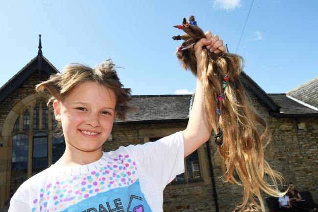 Poppy Coulthard cuts off her hair in aid charity. Photo: HX301913. KATE BUCKINGHAM.