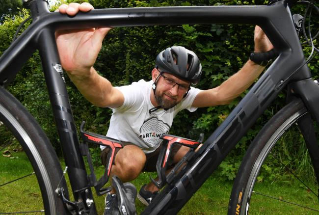 Chris Ponsford completed a bike ride in aid of the charity he's set up to provide woodland therapy for men struggling with mental health problems. Photo: HX311908