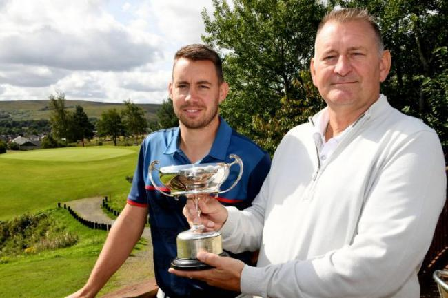 Ben King (left) with his father Michael, who pipped him to last year's title.
