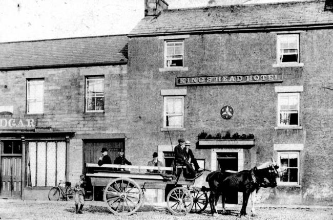 The King's Head Hotel in Allendale, in the days of horse-drawn wagons.