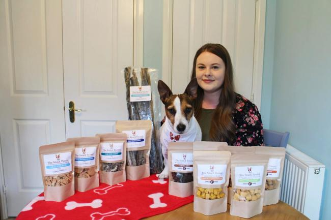 Hannah Connolly, who runs the Snack Pawtal, with her dog Oscar and her Icelandic and grain-free products.