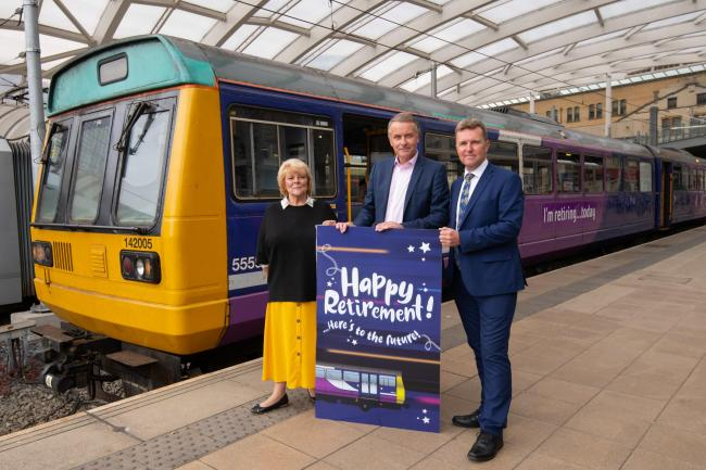 Transport for Greater Manchester committee vice-chairwoman Doreen Dickinson, Northern's managing director David Brown, and Transport Focus director David Sidebottom say goodbye to the retired Pacer.