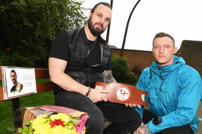 Boxer Dec Spelman dedicates his recent belt win to former boxer Scott Westgarth. Pictured with Scott's brother Adam Westgarth on the memorial bench at The Glade in Prudhoe. Photo: HX371969. KATE BUCKINGHAM.
