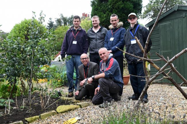 Neil Shashoua from the Lloyds Foundation and handy person service supervisor Dave Rosbotham (front) with from the left, Robert Welsh, Jack Purvis, James Collins and Joe Sanders at St Mary's First School where the Natural Ability team is working in t