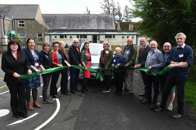 Representatives from the funding bodies behind the Go Gilsland community transport scheme are pictured with the new vehicle outside Gilsland Primary School. 		 Photo: HX381934