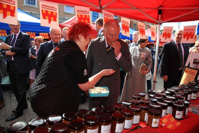 Royal Visit. The Prince of Wales tries some local produce during his visit to a farmers' market in Hexham as he carries out a series of engagements in Northumberland. PRESS ASSOCIATION Photo. Picture date: Wednesday September 12, 2018. See PA story RO