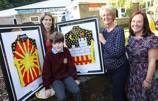 Adam Symes (front) is pictured with his winning jersey designs and (left to right) mum Ruth Symes, Coun. Cath Homer and headteacher Jennifer Ainsley. 				         Photo: HELEN SMITH