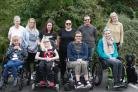 Disabled individuals and their carers enjoy the respite retreat.