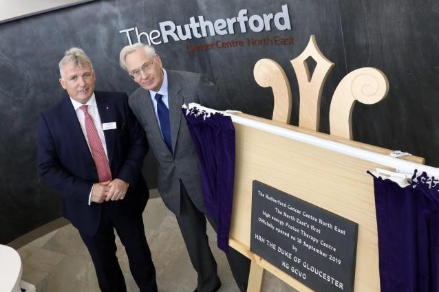 The Duke of Gloucester unveils a plaque to declare the Rutherford Cancer Centre in Bedlington officially open, with Rutherford Health chief executive officer, Mike Moran. 				            Photo: NORTH NEWS