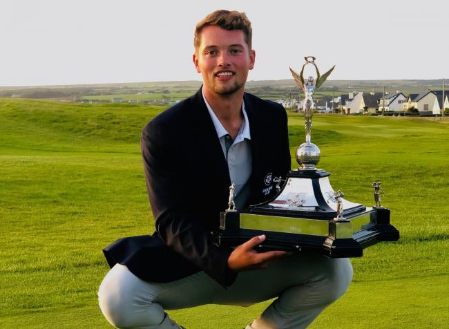 Hexham golfer Matty Lamb with the Home International Trophy.