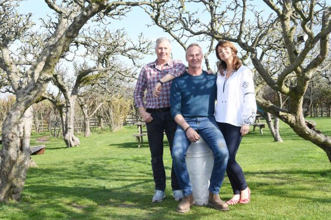 Hugh, Tom and Lucinda Richardson in the orchard at Wheelbirks ice cream parlour, which will be open to the public this weekend.                                    Photo: KATE BUCKINGHAM