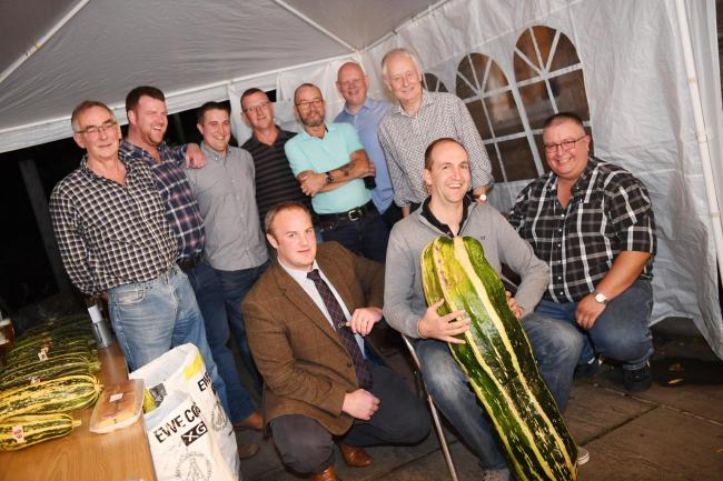 Winner of the annual Barrasford Arms Marrow Show, James Walby (front centre), with judge John Walton (front left) and committee members Ian Stewart (front right) Jack Proudlock, Steven Pigg, Gary Stewart, Richard Thomas, Brian Williams, Duncan Coulson and