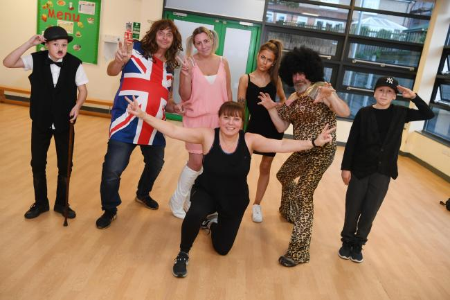 Aston Wilson as Charlie Chaplain; John Hagger, Lija Steel, Sarah Smith, Laura Charlton and William Charlton as the Spice Girls and Christopher Varty as props manager, prepare for the Eurovision dance competition in aid of the Teenage Cancer Trust.