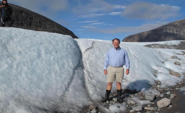 Rob Caskie, who will be delivering a lecture on the North West Passage at the Forum Cinema in Hexham, next to a glacier.