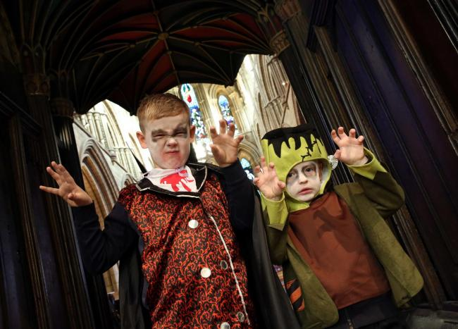 Taking part in one of Hexham's popular Spook Night events at Hexham Abbey is Oscar Green, from Hexham, and Ollie Robertson from Newcastle. 		Photo: PAUL NORRIS