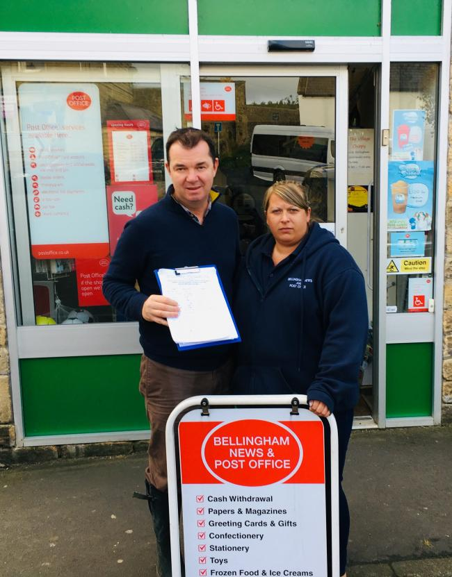 Hexham's MP Guy Opperman and Bellingham Post Office postmistress Kate Jameson with a petition started to campaign against Barclays' plans to remove cash withdrawal services from post offices.