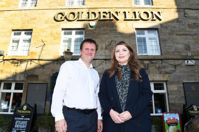 Peter Inness and Amy Fox from the Golden Lion pub in Corbridge, which has made it into the top 10 list of dog-friendly pubs in the North-East. 							                   Photo: HX451967