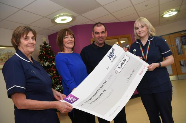 Haltwhistle Memorial Hospital ward manager Val Reynolds (left) and sister Melanie Harrison (right) are presented with a cheque for £5,000 by Ann Charlton and Stuart Wilkie representing Kilfrost. 						            Photo: KATE BUCKINGHAM