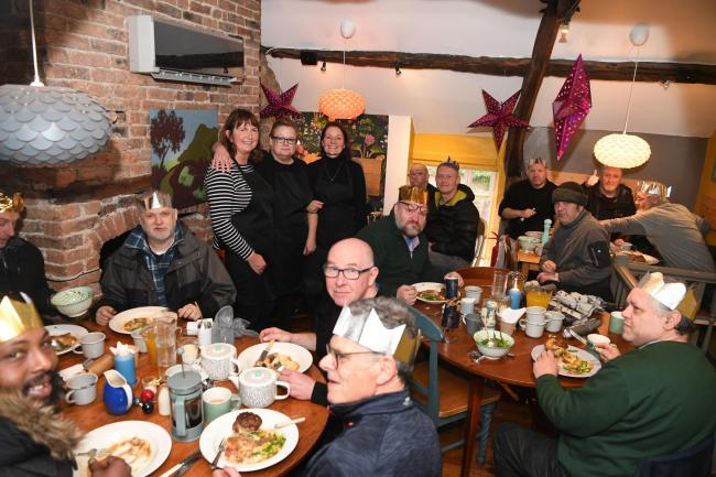 Homeless people tuck into a free lunch at the Four and Twenty restaurant in Corbridge. 				Photo: HX511955