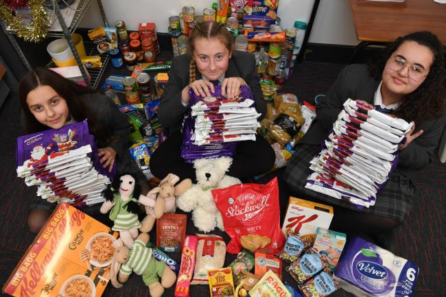 Prudhoe High School pupils Katie Lowes, Emily Bloomer and Yasmin Akkaya with donated items to the West Northumberland Food Bank.