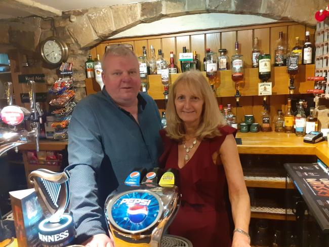 The owners of the Anchor Inn, Gavin and Karen Reay, welcome voters into their pub.