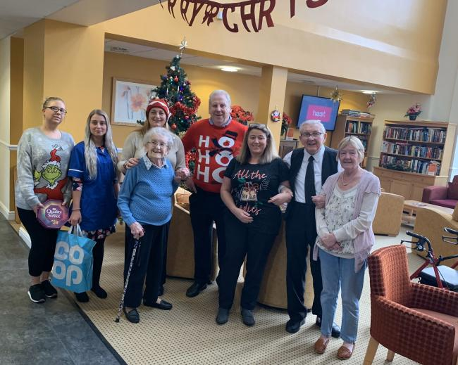Coun. Tracy Gilmore and Coun. Gordon Stewart with staff and residents at the Manors Care Home, Prudhoe on Christmas Day.