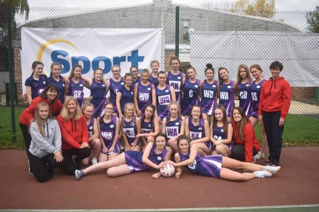 Lead coach Kathie Keady (middle left) with players and other coaches at Hexham Junior Netball Club.