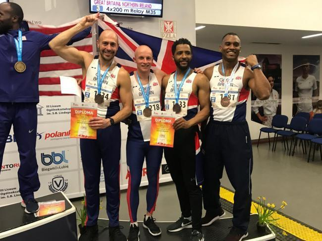 Darren Towart (left) with Great Britain teammates David Brown, Peter Hall, and Mensah Elliott in Poland last year.             Photo: DOUG SMITH