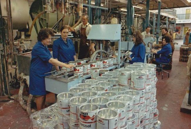 Workers fill cans of paint at the Crown Paints Factory in Haltwhistle. From the left, Sadie Venables, Carol Smith, Tommy Glenwright, Susan Bell, Norman Shepherd, Kathleen Roberts and Tony Murray.       Photo: ELAINE ABBOTT