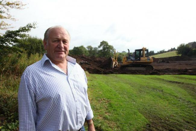 Northumberland county councillor Ian Hutchinson at the Haltwhistle Burn football pitch during works.