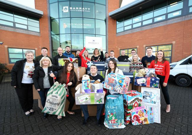 Staff at Barratt Developments with some of the gifts they collected for disadvantaged children in the North-East.