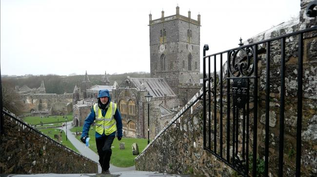 Daft as a Brush founder Brian Burnie walks through the grounds of St David's Cathedral, in Wales.