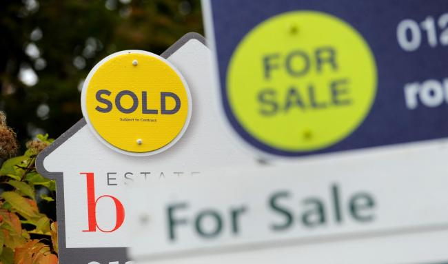 File photo dated 14/10/14 of sold and for sale signs. House sellers may find that they achieve their maximum selling price if their property is snapped up after two weeks, analysis suggests. PA Photo. Issue date: Friday February 14, 2020. Data from more t