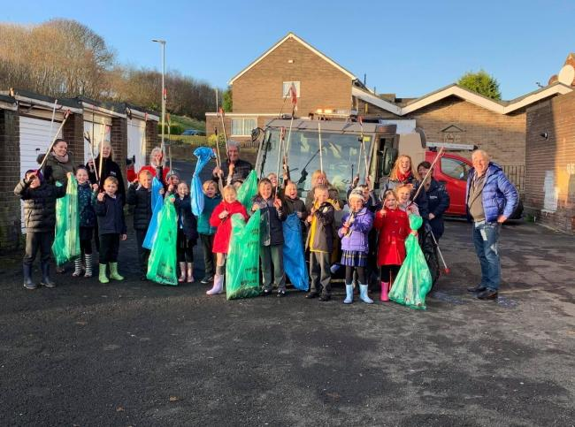 Representatives from Northumberland County Council, Karbon Homes, and West Wylam businesses worked together on a litter pick with children from Adderlane Academy.