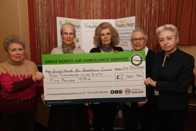 Mary Reed, Amy Walton, Angela Stokoe and Kathleen Handyside from Mary's Healthy Weigh club present Pat Ford, volunteer at the Great North Air Ambulance Service, with a cheque for the money raised by the group. 				              Photo: HX032030