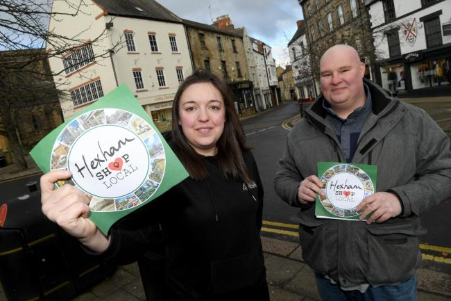 Zoe Phillipson and Edd Green with the logo for the relaunched Hexham Shop Local campaign. 													  Photo: HX052050