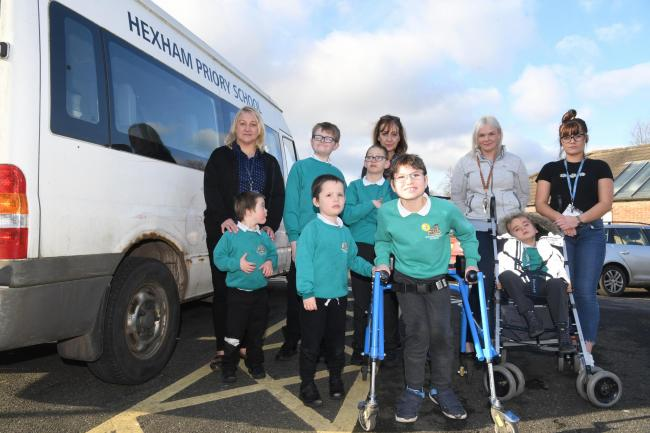 From the left, Ben Kirtley, Sarah Nixon, Alfie Harrison, James Darling-Robinson, Mark Jones, Liz Davison, Callum Tomkins, Louise Atkinson, Alexander Nelson and Danielle Baxter next to the Hexham Priory minibus that needs replacing. 			Photo: HX052052