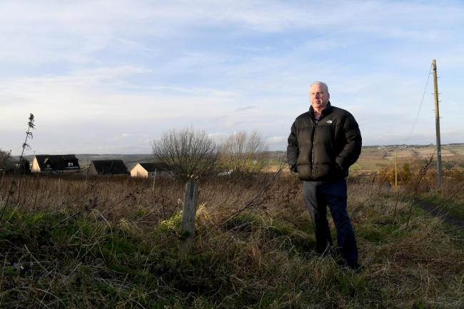 Coun. Gordon Stewart on the area of land to be developed by Northumberland Estates in Prudhoe. 							Photo: HX052066