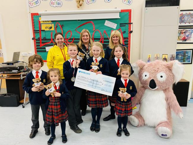 Back row, Prudhoe Plodders representative, Holly Kelleher, Prudhoe town mayor Coun. Tracy Gilmore and Essity site assistant, Cath Frost pictured with youngsters from St Matthew's Primary School. Photo: GEORGIA LANGDON
