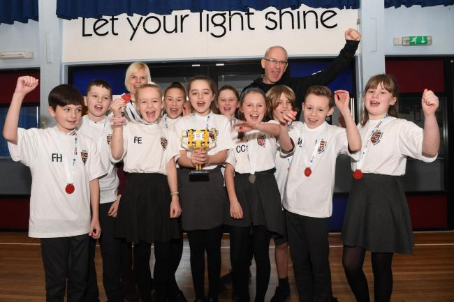 Year 6 pupils from Richard Coates Primary School celebrate winning the robot design award with teachers, Carly Robinson and Ian Runciman. 							  Photo: HX062052