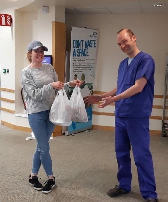 Karen Robinson, the owner of Top Nosh, delivers food to staff at Burn Brae Medical Group.