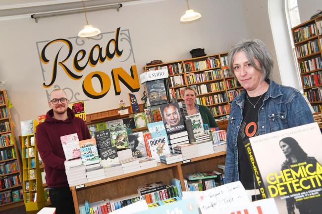 Owner of Forum Books, Helen Stanton, and her staff celebrate their recent success in the awards. Photo: KATE BUCKINGHAM